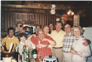 in the front, Aunt Janet, Aunt Elaine, my mother Joy (being squeezed by Uncle Jack P); second row Uncle Jack C, Uncle Jim, my father Ross, Aunt Patsy; back row Aunt Margery (partially hidden), Aunt Patty, Uncle Bruce. Uncle Walter is the photographer.
